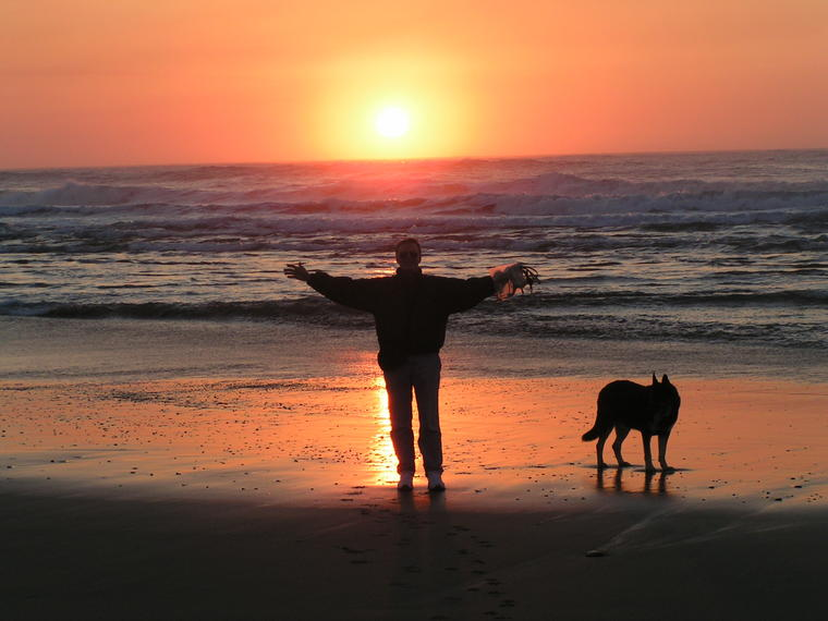 Ed and Max Walking at Sunset on Bandon Beach